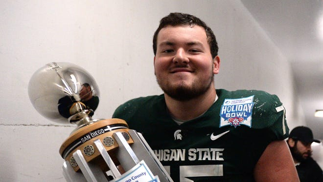 Kevin Jarvis, left, moved into a starting role at right guard as a true freshman for Michigan State last fall.