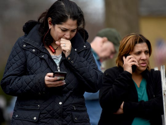 Eliana Conti, on left, tries to find out information regarding a lockdown at Dumont High School while waiting to her from her fifteen-year old daughter, Valeria Monje. Dumont High School was placed under lockdown on Monday afternoon after a threat was found on social media from a fifteen year-old sophomore. The student was arrested at 1:15 p.m. and a gun was found at his home while the high school was under lockdown on Monday, February 26, 2018.