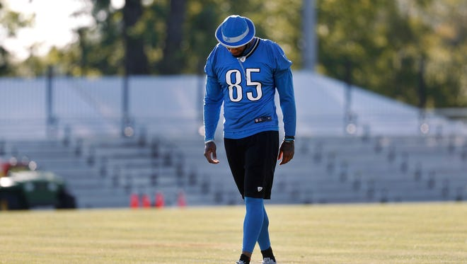 Detroit Lions tight end Eric Ebron walks on the practice field during NFL football practice in Allen Park, Mich., Monday, Aug. 8, 2016. Ebron left the team's annual mock game on Saturday on the back of a cart due to an injury.