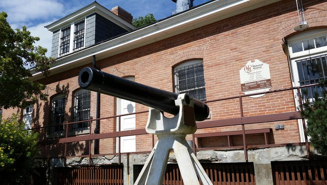 A salute gun stands outside the Historical Museum at Fort Missoula. The breech-loading gun was used from 1883-1942 for reveille and retreat ceremonies. The Historical Museum's main building was built for the Army in 1911 as a quartermaster's warehouse and currently has displays telling the history of the fort and Missoula County.