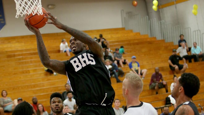 Bremerton's Marvin Williams shoots during a Kings of Kitsap Alumni Basketball Tournament game Saturday at Bremerton High School. Bremerton won the tournament by defeating Central Kitsap on Sunday.