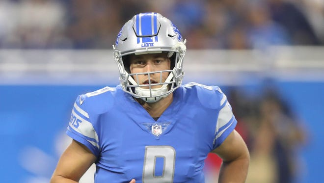 Matthew Stafford runs to the sideline in the first half against the Patriots on Aug. 25, 2017 at Ford Field in Detroit.