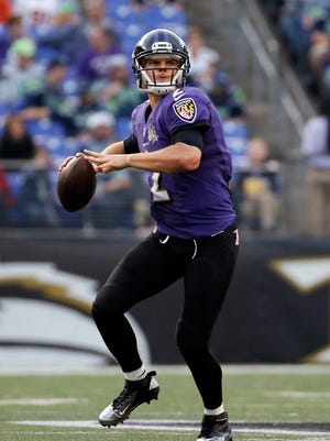 Baltimore Ravens quarterback Jimmy Clausen throws to a receiver in the second half an NFL football game against the Seattle Seahawks, Sunday, Dec. 13, 2015, in Baltimore.