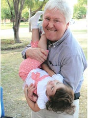 Dr. David Hartman, retiring as senior pastor of First Christian Church of Wichita Falls, plays with Emma, shown at 3 years old, his youngest of four children. Emma is now 9.