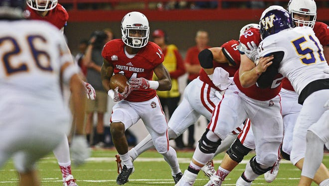 USD's Michael Fredrick (14) finds room to run during a game against Western Illinois Saturday, Oct. 29, 2016, at the DakotaDome on the University of South Dakota campus in Vermillion, S.D.