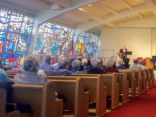Trumpeter Joe Jamerson performs in the sanctuary at