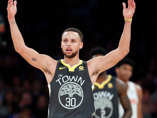 Golden State Warriors forward Stephen Curry celebrates toward fans during the second half of an NBA basketball game against the New York Knicks, Monday, Feb. 26, 2018 in New York. The Warriors defeated the Knicks 125-111. (AP Photo/Kathy Willens)