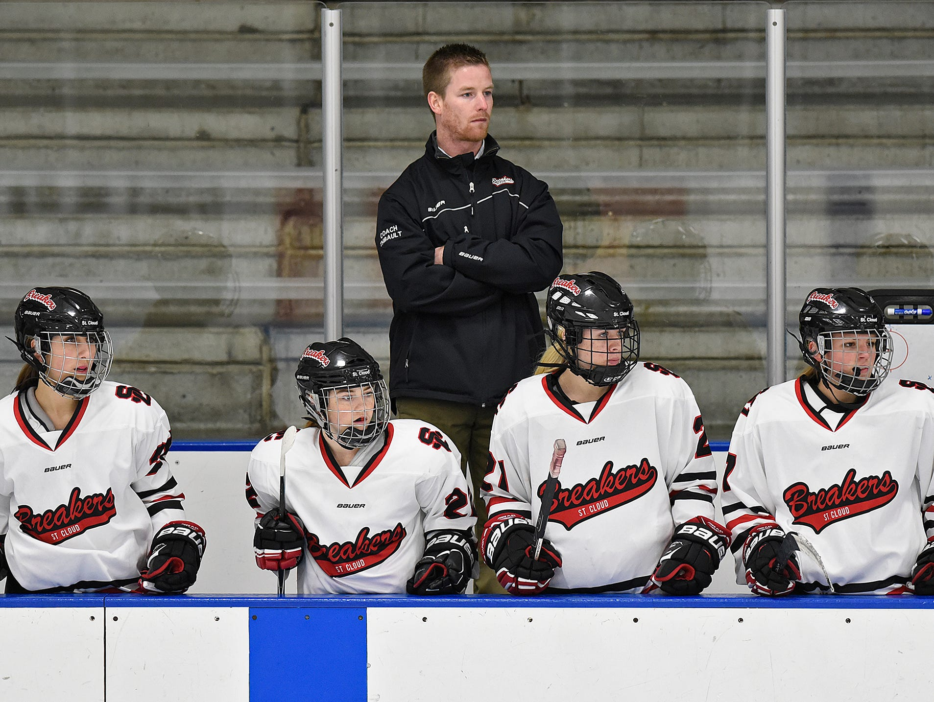Nick Thibault watches his team from the bench during a game Thursday at the MAC in St. Cloud. Thibault is in his first season as the head coach for the St. Cloud Icebreakers.