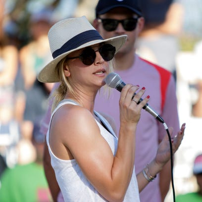 Actress Kaley Cuoco introduces herself to the crowd