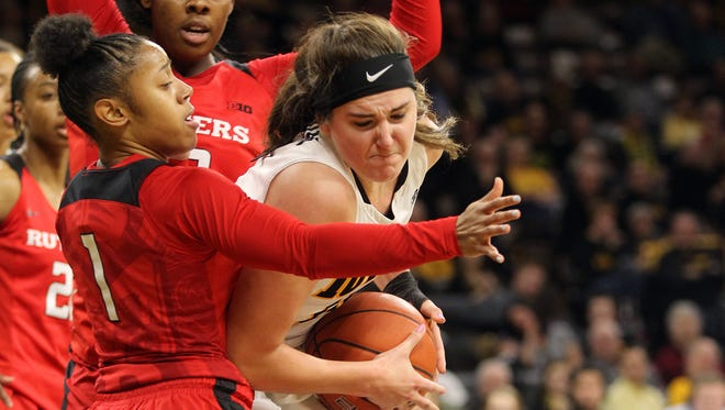 Iowa's Megan Gustafson fights off defenders during the Hawkeyes' game against Rutgers at Carver-Hawkeye Arena on Thursday, Feb. 2, 2017.