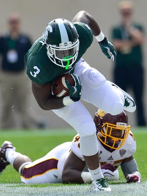 Michigan State running back LJ Scott (3) leaves Central Michigan defender Tim Hamilton on his face while he sprints upfield for a second-quarter first down.