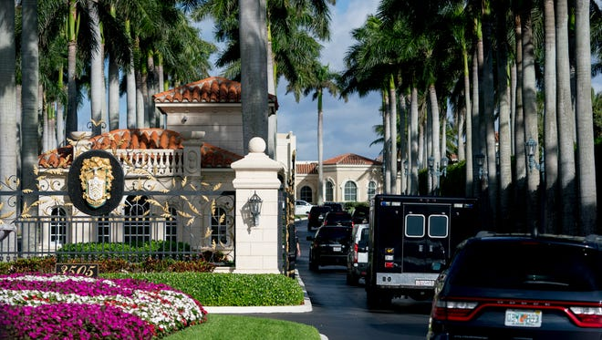 A motorcade carrying President Trump arrives at Trump International Golf Club in West Palm Beach, Fla., on Monday.
