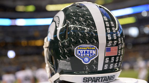 MSU senior receiver Tony Lippett warms up the Cotton Bowl. It appeared MSU was headed for the Orange Bowl until a bizarre flip in the rankings on Dec. 7.