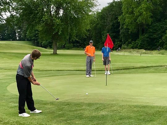 Marion Harding's Kameron Hall chips onto a green during Tuesday's Heart of Ohio Junior Golf Association season-opening tournament at Lincoln Hills in Upper Sandusky. Hall won a playoff to win the 16-to-18 age group.