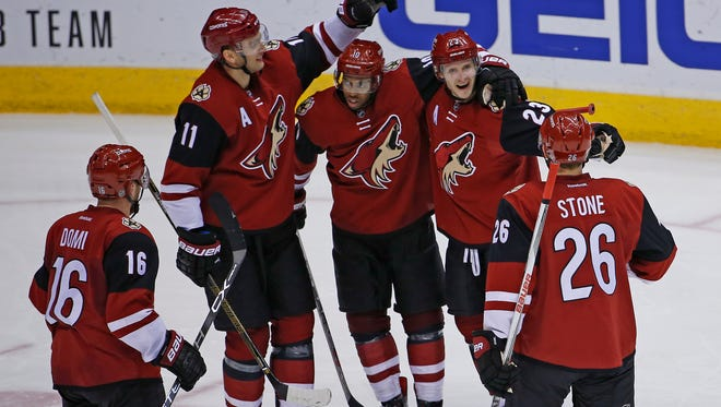 The Coyotes gather to celebrate with Oliver Ekman-Larsson after his goal in the second period against the Canadiens at Gila River Arena in Glendale on Monday, Feb. 15, 2016.