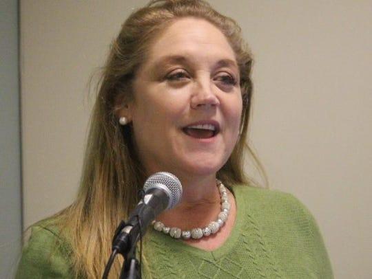 Civil rights attorney Annabelle Robertson speaks Sunday
