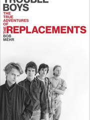 """Tommy Stinson, front, scowls on the cover of The Replacements biography """"Trouble Boys."""" Stinson was approximately 14 when the photo was taken."""