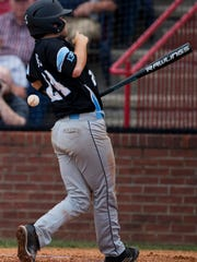 Union County's Coy Burns is hit by a Trigg County pitch