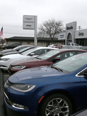 Chrysler cars line the parking lot at the Livonia Chrysler Jeep dealership in Livonia.