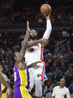 Pistons center Andre Drummond scores against Lakers forward Tarik Black during the first period Wednesday at the Palace.