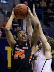 Oregon State's Kendal Manuel (24) shoots against California's Sam Singer during the first half of an NCAA college basketball game Friday, Feb. 24, 2017, in Berkeley, Calif. (AP Photo/Ben Margot)