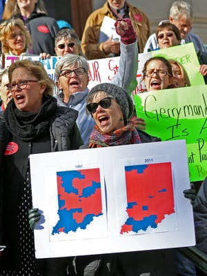 People gather to rally about redistricting reform, on Organization Day at the Indiana Statehouse, Tuesday, Nov. 21, 2017.