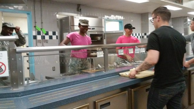The cooks at the 327th Infantry Regiment at Fort Campbell wore pink T-shirts for Pink Out Day in support of breast cancer awareness.