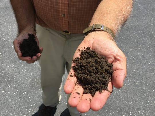 """Ken Fanfoni, executive director of the Middle River Wastewater Treatment Plant, holds dried out sludge, known as """"cake,"""" which was taken to the Augusta County Landfill."""