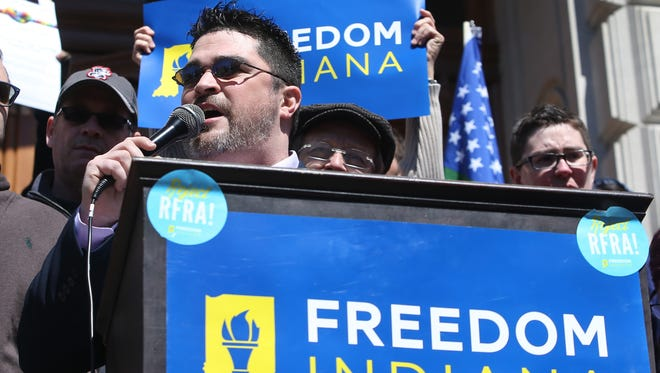Gay City-County Councilman Zach Adamson speaks to several thousand opponents of Indiana's Religious Freedom Restoration Act as they gather for a rally on the steps of the Statehouse on March 28, 2015, in Indianapolis. Many opponents of the law worry that it will allow businesses and clergy to refuse to serve members of the lesbian, gay, bisexual and transgender community.