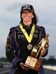 Alexis DeJoria celebrates after winning the Funny Car