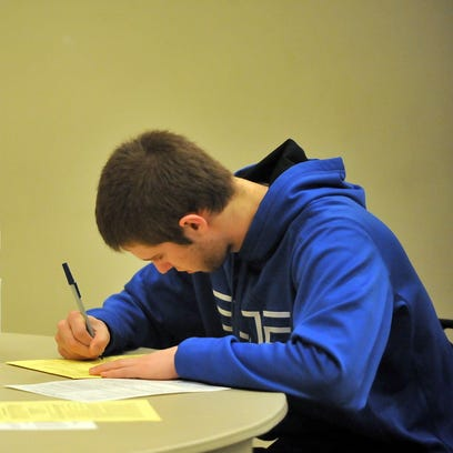 First-time voter Jared Wentz casts a provisional ballot