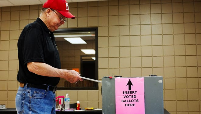 Bill Estlund casts his ballot during the South Dakota Primary election on Tuesday at the Kuehn Community Center in Sioux Falls.