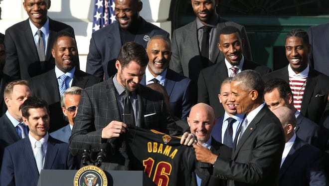 Nov 10, 2016; Washington, DC, USA; President Barack Obama (R) is presented a gift jersey by Cleveland Cavaliers forward Kevin Love (L) at an event honoring the 2016 NBA world champion Cavaliers on the South Lawn at the White House. Mandatory Credit: Geoff Burke-USA TODAY NETWORK ORG XMIT: USATSI-353774 ORIG FILE ID:  20161110_jla_sb4_188.jpg