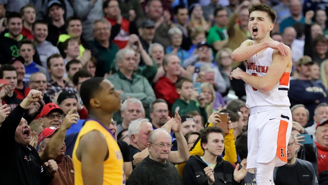 Kaukauna's Jordan McCabe celebrates after the Ghosts defeated Milwaukee Washington 76-74 in the WIAA Division 2 boys basketball state championship game March 17 at the Kohl Center in Madison.