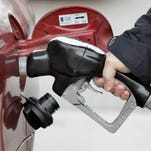 This file photo shows man pumping gas into his car.