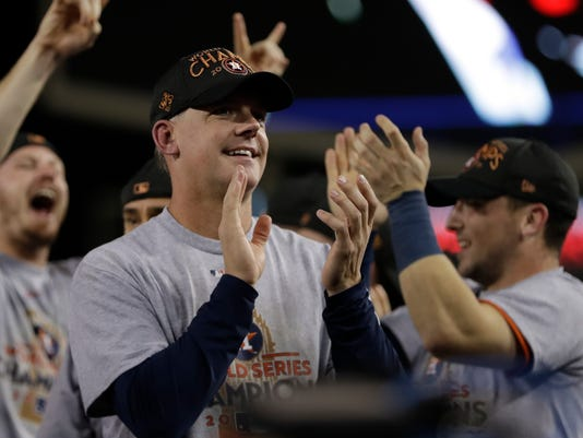 Houston Astros manager A.J. Hinch celebrates after Game 7 of baseball's World Series against the Los Angeles Dodgers Wednesday, Nov. 1, 2017, in Los Angeles. The Astros won 5-1 to win the series 4-3. (AP Photo/Matt Slocum)