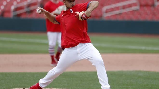 St. Louis Cardinals pitcher Jordan Hicks throws off the mound during practice at Busch Stadium on Friday, July 3, in St. Louis.