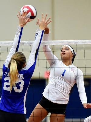 Carson's Ku'ulei Haupu looks to block a shot by Reno's Kaitlynn Biassou in a Regional semifinal game at Reno High School on Nov. 2.