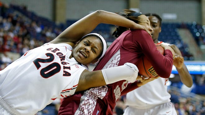 Mar 23, 2014; Storrs, CT, USA; St. Josephs Hawks forward Ashley Robinson (13) works for the round against Georgia Bulldogs guard/forward Shacobia Barbee (20) in the first half of a women's college basketball game in the first round of the NCAA Tournament at Gampel Pavilion. Mandatory Credit: David Butler II-USA TODAY Sports