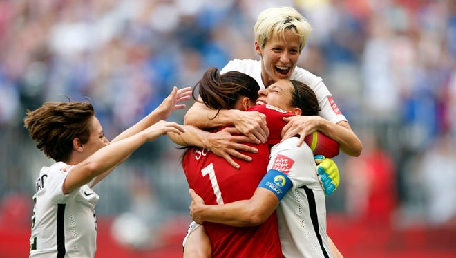 U.S. midfielder Carli Lloyd (10) celebrates with goalkeeper Hope Solo (1), midfielder Megan Rapinoe (15) and defender Meghan Klingenberg (22) after scoring against Japan during the first half of the final of the FIFA 2015 Women's World Cup at BC Place Stadium.