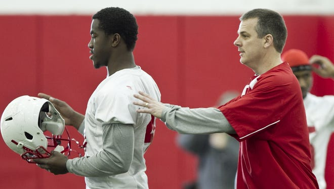 FILE -- Former Nebraska linebackers coach Ross Els, right, has been hired to be the new defensive coordinator for the Purdue football team. Nebraska linebackers coach Ross Els, right, works with linebacker Lavonte David on the first day of spring NCAA college football practice in Lincoln, Neb., Saturday, March 12, 2011. (AP Photo/Nati Harnik)