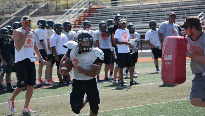 Aztec's Brian Tapia cuts right for some extra yards during practice on Thursday, August 10. The Tigers open the season 7 p.m. Friday at Los Lunas.