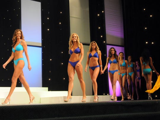 Conteistants walk the stage during the swimsuit competition during last year's Miss Michigan USA pageant at McMorran Auditorium.