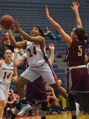 Shippensburg Raiders Lauren Gold (24) takes a shot at the basket while being guarded by Natalya Lee (5) of Kutztown University during a girls basketball game in Shippensburrg, Pa on Saturday, Dec. 19, 2015. Gold scored during the second quarter 17-9.