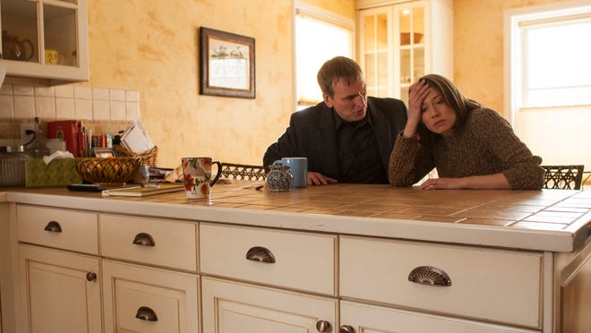 """Christopher Eccleston, left, and Carrie Coon in a scene from """"The Leftovers."""""""