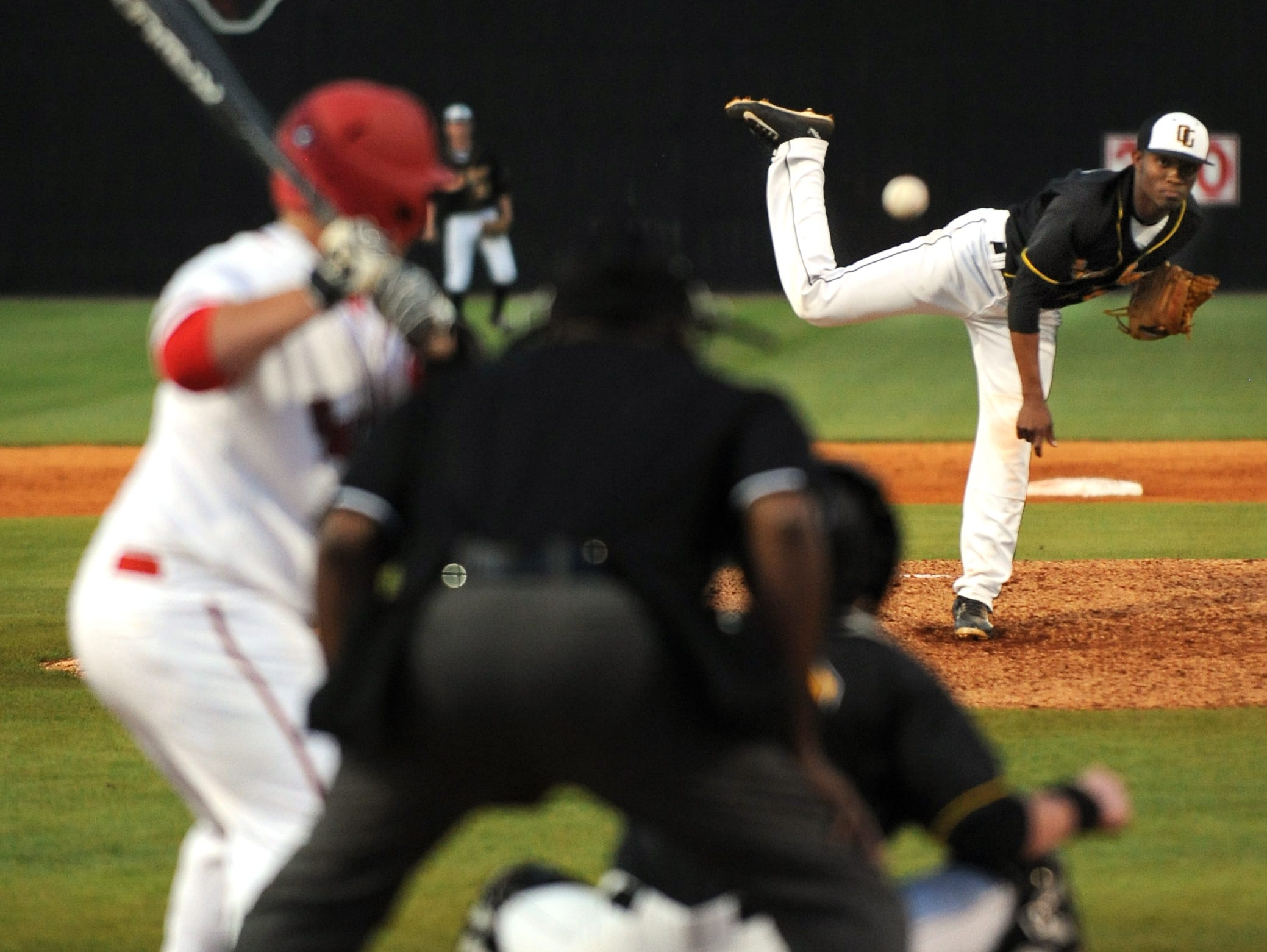 Oak Grove pitcher J.C. Keys (16) delivers a pitch Tuesday during the Warriors' game against the Petal Panthers at Petal High School.