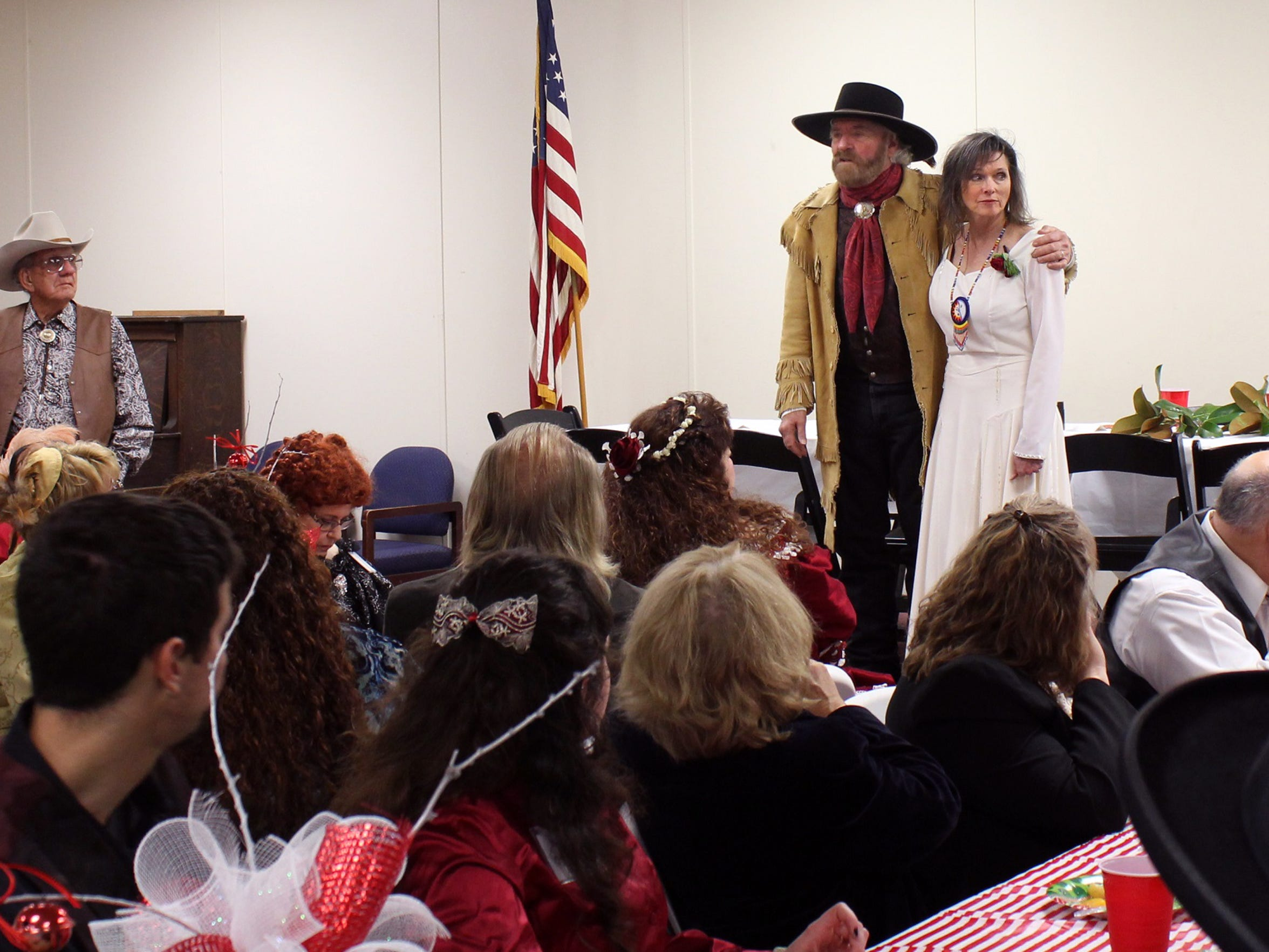 Michael Martin Murphey and his new wife, Cynthia, thank those gathered in a hall across the street from Pioneer Hall in Anson for attending their wedding and supporting the Texas Cowboys' Christmas Ball.