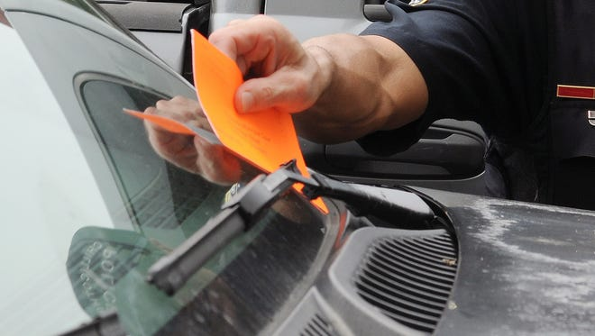 With the time frame involved in City Council's legislative process, it's unlikely parking tickets will begin appearing on motorists' windshields again until around the first of the year.