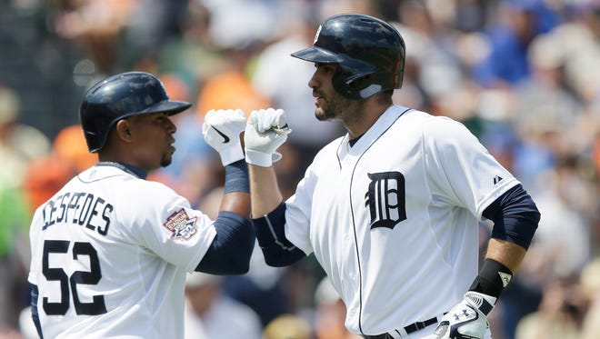 Detroit Tigers' J.D. Martinez, right, is congratulated by Yoenis Cespedes after his solo home run in the first inning of a spring training exhibition baseball game against the New York Mets in Lakeland, Fla., Saturday, March 21, 2015.