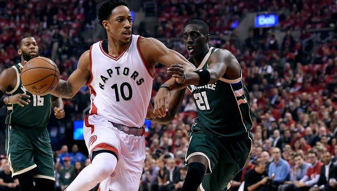 Bucks guard Tony Snell gives chase as Toronto Raptors guard DeMar DeRozan drives in  Game 2